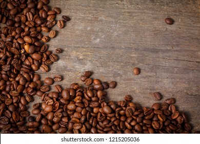 Close up of fair trade coffee beans on old wooden desk