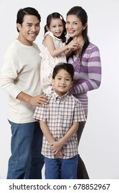 close up of family portrait on white background