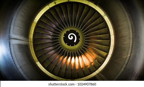 Close up of fan engine and turbine blades of modern civil passenger airplane illuminated beautiful light, front view/ Technology, aircraft construction, aviation concept/ Aircraft engine maintenance