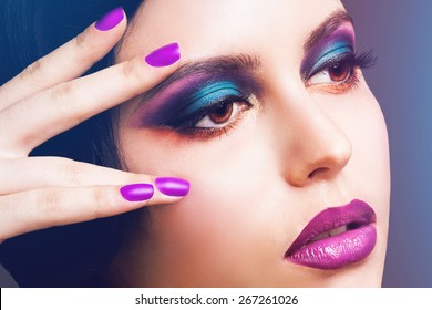 Close up fashion beauty portrait of glamour model with retro style wave haircut , bright smoky eyes and full purple lips.