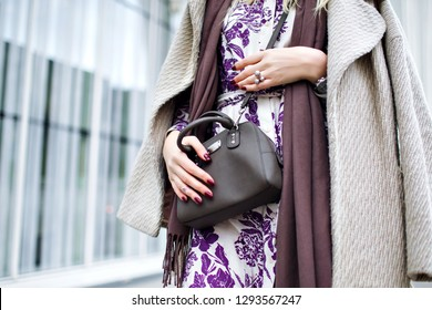 Close up fashion details, taupe trendy colors, woman wearing elegant coat, floral maxi dress, crossbody bag, trendy accessories and jewelry, spring autumn time, burgundy manicure.