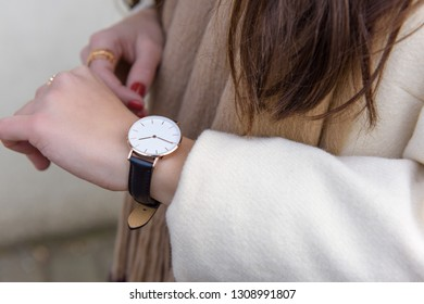 Close up of fashion details, young business woman wearing stylish watch. Fall and winter outfit accessories