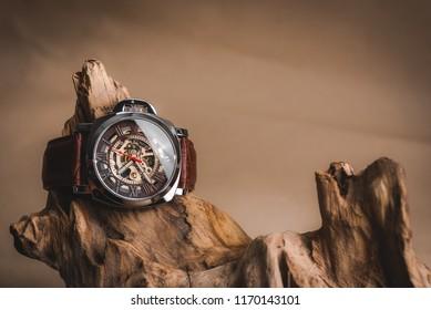 Close up fashion image of luxury wrist watch on timber wood.Fashion business man.