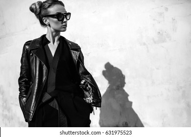 Close up fashion ;luxury portrait of stunning sexy woman, full perfect lips and face, sunny day sunglasses and leather jacket, big trendy earnings, grunge urban style.