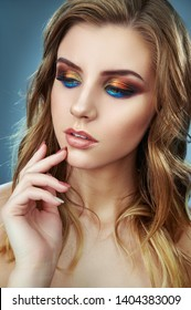 Close up fashion model woman in trendy makeup. Eye models with colorful glitter on the eyelids