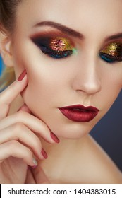 Close up of fashion model young woman in trendy make-up. Eye models with colorful glitter on the eyelids