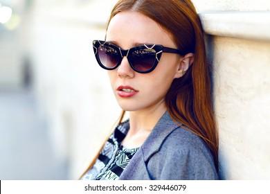 Close up fashion portrait of elegant lady, cat eye vintage glamour sunglasses, long hairs, natural makeup, autumn time.