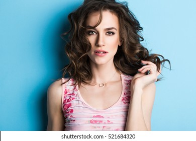 Close up fashion portrait Woman against blue wall background.
