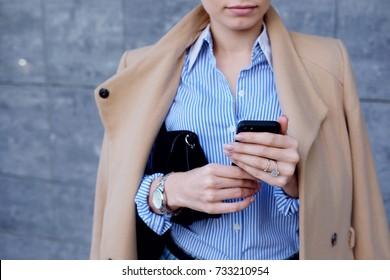 Close up fashion woman hands using modern smart phone