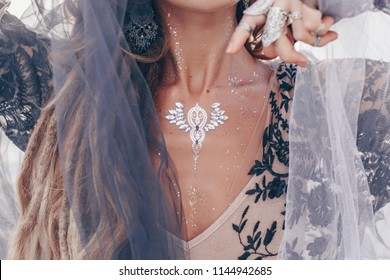 Close up of fashionable stylish woman with boho accessories outdoor
