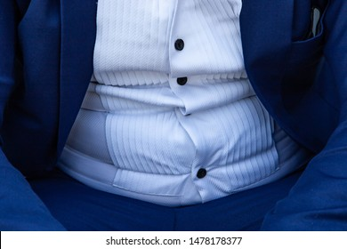 close up a fat man in a suit.symbolic photo for beer belly, unsuccessful dieting and eating the wrong foods,Weight loss concept.man with overweight in suit.