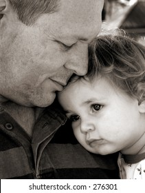 Close up of father and daughter in black and white