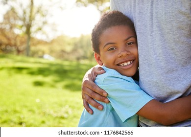 Close Up Of Father Hugging Son In Park