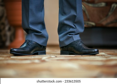 Close up of feet of the man in a suit and shoes