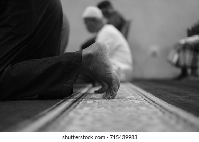 Close up of feet of Muslim man who is performing his sujud as in pray.