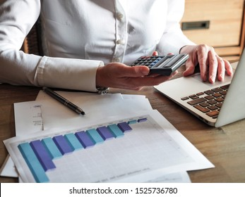 Close up of female accountant of banker making calculations Savings, finances and economy concept.