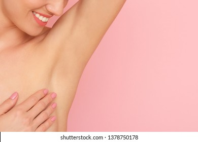 Close up of female armpit isolated on pink background. Smooth and fresh skin after shaving.