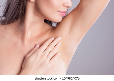 Close up of female armpit. Model touching her axilla.