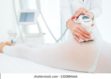 close up of female back and buttocks, in white LPG slimming bodysuit, getting lpg integral massage, which is carried out by the latest generation of devices - lpg integral.