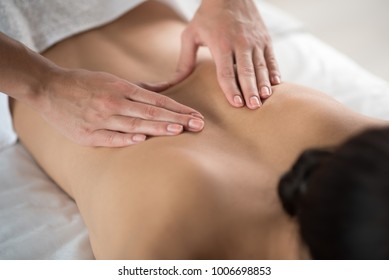 Close up of female back getting massage by professional beautician