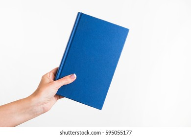 CLose up of female caucasian female woman holding blue book isolated on white background. Horizontal color point of view shot