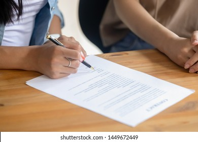 Close up female client signing business contract, making financial legal deal, purchase real estate or taking loan, insurance, candidate putting signature on job agreement after successful interview