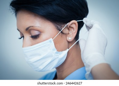 Close up of female dentist wearing surgical mask