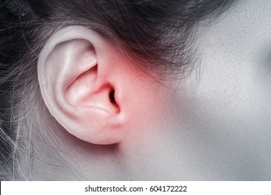 Close up of female ear with source of pain