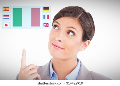 Close up of female entrepreneur pointing and looking up against white background with vignette