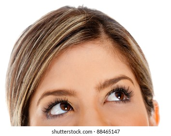 Close up of female eyes looking up - isolated over a white background