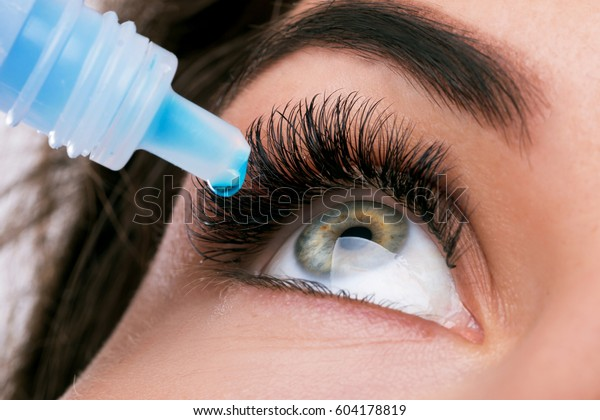 Close up of female face and eye drops