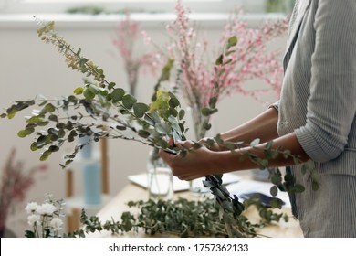 Close up of female florist arrange bouquet make beautiful floral compositions at home, woman interior designer compose flowers in handmade decorations for sale, house decor, gardening concept