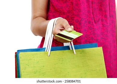 Close up of female hand holding shopping bags and credit card