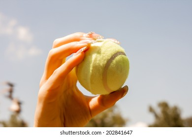 close up of female hand holding tennis ball