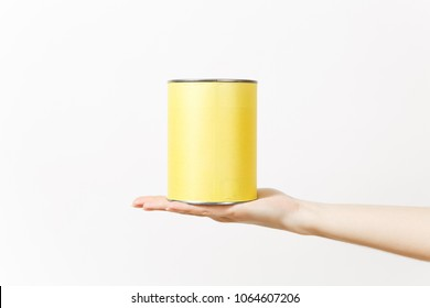 Close up of female hand horizontal holds empty paint tin can with copy space isolated on white background. Instruments, tools for renovation apartment room. Repair home concept. Advertising area