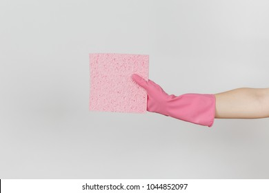Close up of female hand in pink gloves horizontal holds pink absorbent napkin for cleaning and washing dishes isolated on white background. Cleaning supplies concept. Copy space for advertisement.