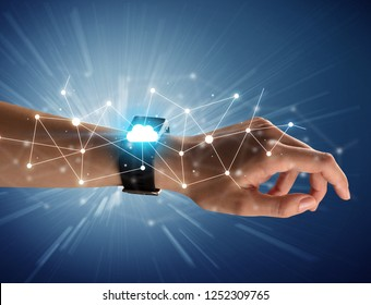 Close up female hand with smartwatch and with cloudy and connection icons around