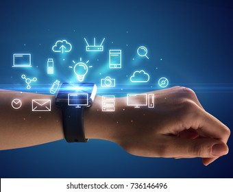Close up female hand with smartwatch and multimedia symbols around and blue background