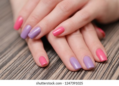 Close up of female hands with bright fingernails