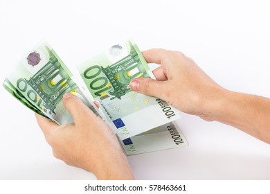 Close up of female hands counting 100 euro banknotes isolated on white background