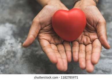 Close up female hands giving red heart as heart donor. Valentine day of love concept. Medical ventilator and heart donator charity. Sign of compassion and healthy. Helping hand in freedom life