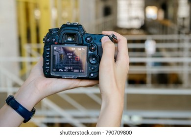 Close up female hands hold professional camera