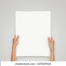 Close up of female hands holding blank book isolated with copy s