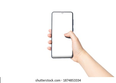 Close up of female hands holding mobile smart phone with white blank screen isolated on white background. Touch on screen by finger for chatting, playing game or reading something. Mock up.