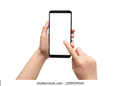 Close up of female hands holding and pointing mobile smart phone with white blank screen isolated on white background. Mock up. Copy space.