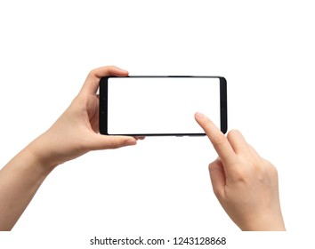 Close up of female hands holding and pointing horizontal mobile smart phone with white blank screen isolated on white background. Mock up. Copy space.