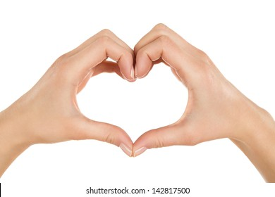 Close up of female hands making heart shape isolated on white background