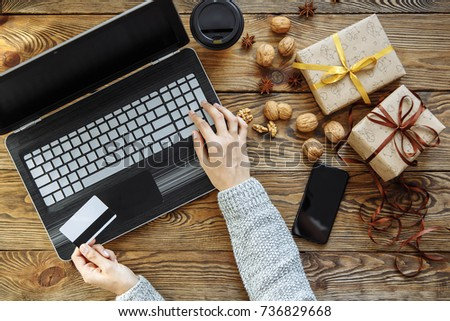 close up of female hands making online purchase using laptop and credit card the concept