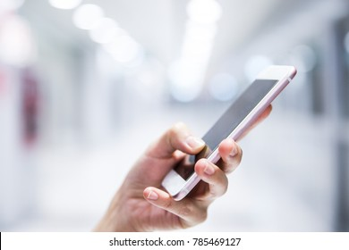 Close up of female hands using smart phone at the office, searching or social networks concept, hipster lady typing an sms message,