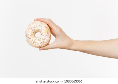 Close up female holds in hand colorful white donut isolated on white background. Proper nutrition or sweets, dessert fast food, dieting morning concept. Copy space for advertisement. Advertising area